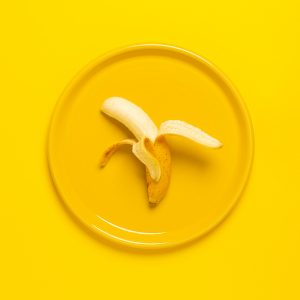 Fresh banana on yellow plate